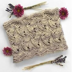 The pattern is in the round, worked in a delightful lace-on-every-round pattern that results in a tilted diamond pattern with scalloped edges. the bulky weight yarn gets you an FO in just a few evening's worth of knitting. Find this cowl pattern at LoveKnitting!
