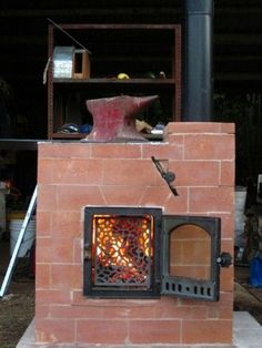 fire going in hybrid cabin stove - link to download plans, also has plans for a barrel oven