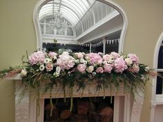Blush and ivory mantlepiece and top table flower design for a Headlam Hall wedding. Flowers by Fleur Couture, featuring hydrangea, roses, amaranthus, lisianthus and more.