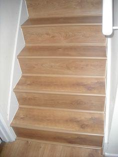 Stairs done in laminate floor. Laminate Flooring On Stairs, House Renos, Dining Room Table, Solid Wood, Basement, Tables, Projects, Inspiration, Home Decor