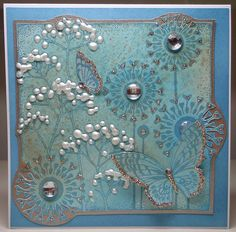 card in blues with an art deco feel...luv the blobby flower spots of Perfect Pearls and the edge treatment with parts of the image going over the edges...