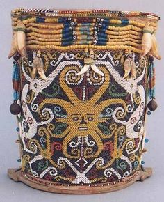 Dayak tribe's baby carrier. Beautifully crafted from small glass seed beads. The baby was 'protected' by a yellow spirit face and two white dragons.