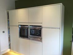 Kitchen appliance bank with storage and beautiful feature wall.  #neffUK #burbidge #kitchens