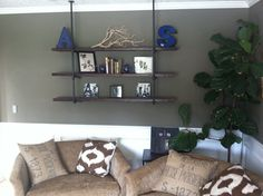 Home made shelves with cast iron piping.