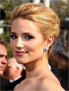 Glee star Dianna Agron sweeps her hair into a classic bun. Nice makeup and hairdo for brides, too!