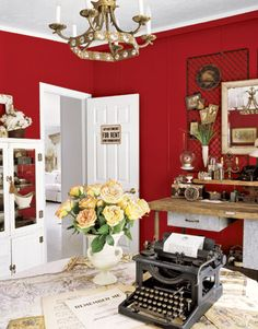 Love the white trim against the red walls with the yellow roses thrown in--beautiful!
