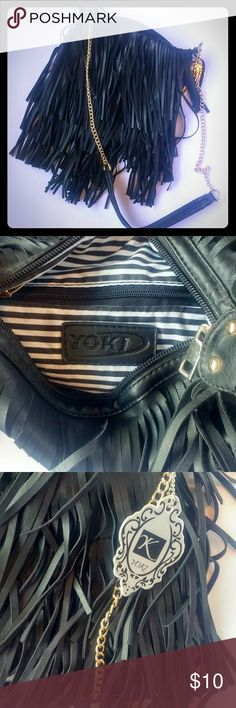 "🐝FRINGE CROSSBODY PURSE🐝 This black fringe cross body purse with a gold chain strap is selling for just 10$, perfect for MANY different outfits and is the perfect size! There is a flaw on the ""I"" of the Yoki writing inside the purse shown in the photo but flawless other than that and still has the Yoki tag attached, NEVER USED! Yoki Bags Crossbody Bags"