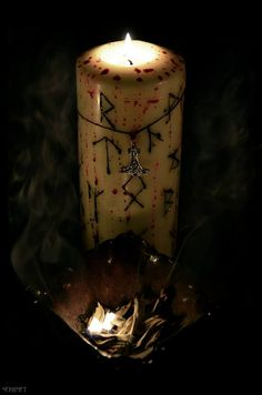 Rune Candle and Mjölnir. Witch craft pagan wiccan inspiration