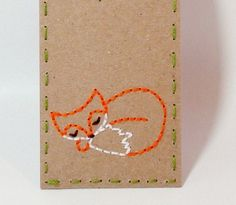 Sleeping Fox Bookmark Hand Embroidered Kraft Paper Books Orange White. $5.00, via Etsy.