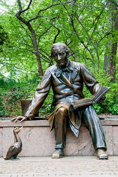 See the bronze statue of Hans Christian Andersen in Central Park (Hans is reading his story The Ugly Duckling to the duck sitting at his feet).