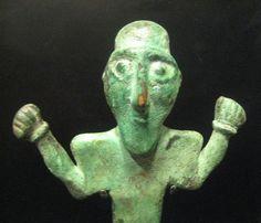 "Elamite Bronze Votive Figure - Origin: Central Asia Circa: 2500 BC to 1500 BC Dimensions: 10.4"" (26.4cm) high x 5.0"" (12.7cm) wide Collection: Near Eastern Medium: Bronze"
