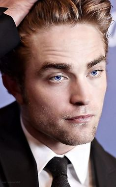 Robert Pattinson e seu doce olhar.