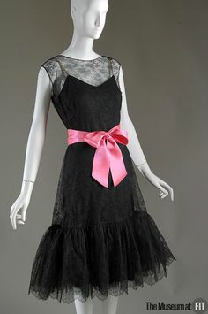 Cristobal Balenciaga (French, founded 1949), Evening dress, c.1957. Black net lace, black silk crepe and pink satin ribbon. Gift of The Costume Institute of The Metropolitan Museum of Art from the Estate of Ann E. Woodward. 87.158.2. The Museum at FIT 2012 © The Museum at FIT.