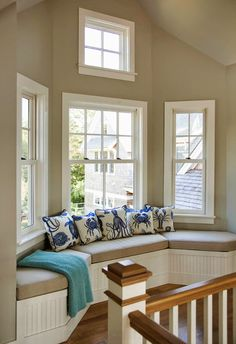 window seat | Martha's Vineyard Interior Design. Hmmm...... could I do Alison's quilt in blue and yellows, with sea inspired silhouettes in the blue patterns?