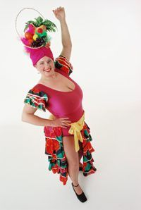 A fun and vibrant headpiece can be made from fabric and artificial fruits.