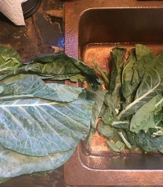 A photo ofThe first wash for the collard greens - going in the bath with the vinegar