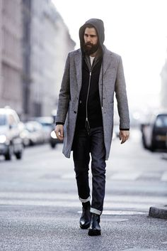 Wear a grey overcoat and black jeans for your nine-to-five. Feeling inventive? Complement your outfit with black leather chelsea boots. Shop this look for $195: http://lookastic.com/men/looks/chelsea-boots-jeans-overcoat-hoodie-scarf-crew-neck-t-shirt/5084 — Black Leather Chelsea Boots — Black Jeans — Grey Overcoat — Black Hoodie — Charcoal Scarf — White Crew-neck T-shirt