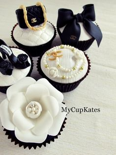 6 Chocolate cupcakes with chanel design...   Everything is made of sugar fondant.  chanel necklace, ring, bag, shoe, ribbon, flower..