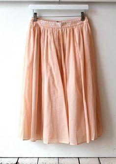 peach skirt...love the triangle print details.