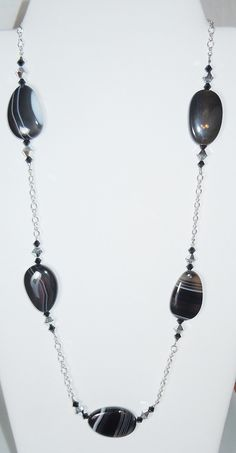 A personal favorite from my Etsy shop https://www.etsy.com/listing/287169061/swarovski-crystal-beads-and-black-agate