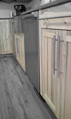 Beetle kill pine kitchen cabinets by Denver-based Blu Cabinetry.