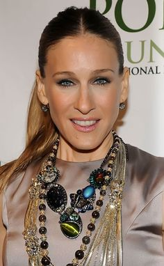 Sarah Jessica Parker inspiration. Love the top, all the necklaces, make up and the ponytail