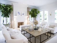 Pretty natural colored living room.  The contrast of the fig trees look beautiful.