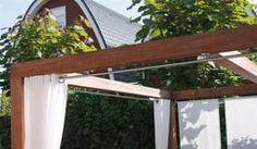 Tolle Pergola mit Gardinensystem für einen Ibiza Lounge Effekt