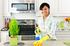 woman cleaning kitchen.jpg