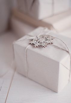Simple white gift wrap adorned with a snowflake.