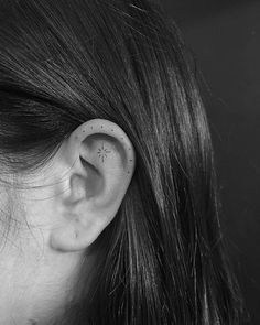 Minimalist star tattoo on the left ear. Tattoo Artist: Michelle Santana