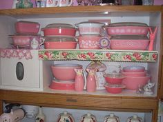 Pink Pyrex Hoosier cabinet display by jazzejunqueinc, via Flickr
