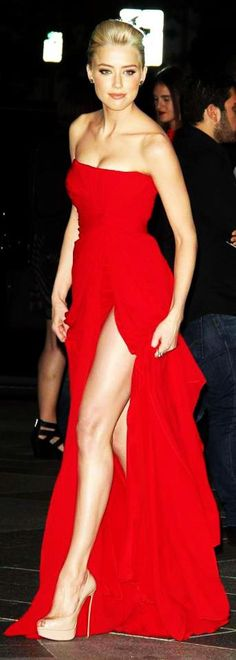 Amber Heard looking stunning! that's how a red dress should be worn! Nude shoes are perfect to complement it
