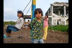 Children play near one of the few ruins left after the 2004 tsunami in the neighborhood of Ulee Lheue in Banda Aceh, Indonesia. 'The Acehnese people have bounced back from the tsunami in such an awe-inspiring way, it was incredible to witness.'Ann Hermes