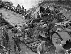 world_war_two - canadian_army - Bridge Crossing - A General Motors Staghound armoured car of the Manitoba Dragoons crossing a Bailey bridge, Elbeuf, France, August Ww2 Pictures, Ww2 Photos, Canadian Soldiers, Canadian Army, British Army, British Tanks, Military Guns, Military History, Historia