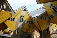 Cubic Houses (Kubus woningen) (Rotterdam, Netherlands). The original idea of these cubic houses came about in the 1970s. The cubes contain the living areas, which are split into three levels. The triangle-shaped lower level contains the living area. The middle level contains the sleeping area and a bathroom, while the top level, also in a triangular shape, is used as either an extra bedroom or a living space.