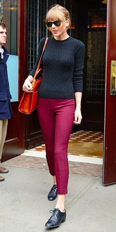 Shop this look on Lookastic: https://lookastic.com/women/looks/crew-neck-sweater-capri-pants-oxford-shoes-satchel-bag-sunglasses/8377 — Black Crew-neck Sweater — Black Sunglasses — Red Leather Satchel Bag — Hot Pink Capri Pants — Black Leather Oxford Shoes