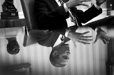 """Nov. 4, 2013 """"The President is reflected in a glass table top during a meeting in the Oval Office."""""""
