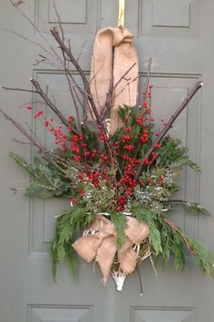 More Christmas garden junk decorating.  I like to use and reuse what I have laying around.  In this case a wire basket, evergreens, berries and some branches.  Burlap is woven through the wire and used to hang.  Fun!