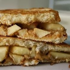 Grilled Peanut Butter Apple Sandwiches - These sandwiches are a simple, but impressive, combination of flavors perfect for after-school snacking or a quick lunch. Great with a glass of cold milk!