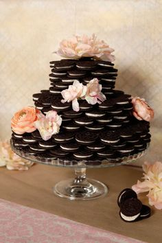 Oreos have never looked as good as this . . . all dressed up and ready for wedding bells to start ringing! Check out how easy it is to put together the Oreo wedding cake of your dreams. We bet you can't guess just how many packages of Oreos it takes to pull this off.
