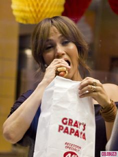 "Jennifer Lopez eats a hot dog while filming ""The Back-Up Plan."""