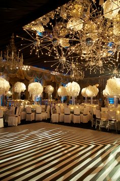 "Wedding with black and white stripe dance floor, chrystal art deco style centerpieces with white orchids and custom built ""Sputnik"" silver ball lights. As seen in Grace Ormonde Wedding Style. By SBK Event Design"
