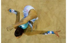 Silver medallist Alexandra Soldatova of Russia performs her exercise with ball at the individual final of