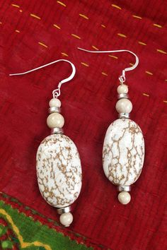 - These Earrings were hand-made and the proceeds go to support survivors of human trafficking - Made with Picture Jasper and Howlite Stone - Sterling Silver Hooks This product was MADE BY FREED because EACH ONE MATTERS!