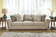 Showcasing the best in casual classic style, Baxley sofa is sure to feel right at home—now and for years to come. In lieu of traditional back cushions are highly supportive back pillows that enhance Baxley's relaxed air. Easy on the eyes and the body, Baxley offers our signature UltraPlush seat cushioning, along with delightfully soft chenille upholstery in a rich textural tweed. Assortment of feather-filled designer accent pillows is pure artistry.