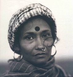 """In Dhaka I met Bibi Russell, designer and vigorous defender of the handloom weavers, whose craft has made a unique contribution to Bengali art and tradition……..She wears a dramatic blue and green saree, hand- loom cloth, which cost 145 taka - itself the most eloquent tribute to the beauty of the work of people she wants to rescue from the demoralisation we saw in Shahjatpur. [X] """"The garments industry is here only for cheap labour. They say we cannot produce the fabric. ..."""