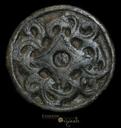 29.67 mm. 9th-11th century AD. A classic form of Viking or Anglo-Scandinavian disc brooch, with a panel of four radiating arms developing into a complex Borre Style motif. The catchplate and pin-lug are present on the reverse.