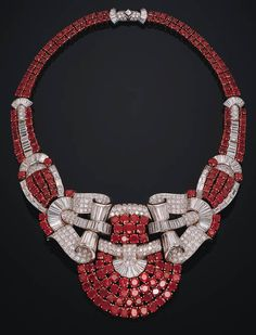 A FINE RUBY AND DIAMOND NECKLACE   The front designed as four rows of rubies to twin baguette and circular-cut diamond scrolls to the ruby and diamond shoulders and twin-row backchain, mounted in platinum and 18k gold, 41.5 cm.