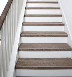 interior-wood-plank-tile-on-staircase-with-white-painted-railings-ideas-wood-plank-tile-wood-plank-tile-design-wood-plank-tile-in-kitchen-wood-plank-porcelain-tile-wood-plank-ceramic-tile. Tiled Staircase, Staircase Remodel, Wood Stairs, Basement Stairs, Staircases, Tile On Stairs, Stairs Tiles Design, Staircase Storage, Wood Railing